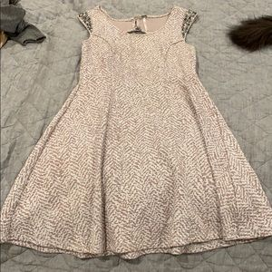 Adorable dress with attached jewels on sleeves
